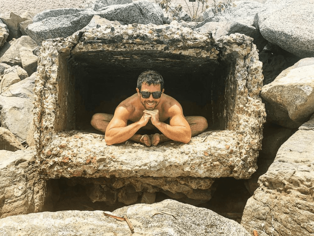 jordan berger yoga pose in cave
