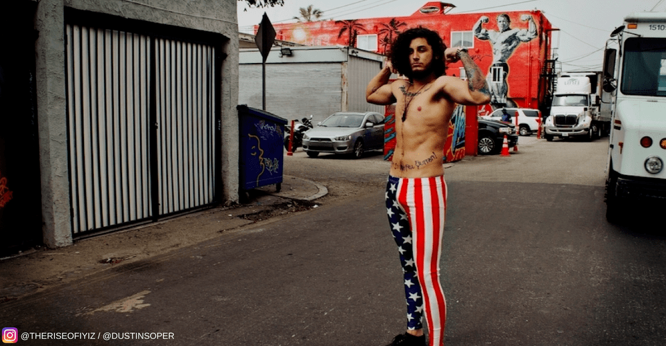 rock and roll guy flexing muscles in stars and stripes meggings with arnold schwarzenegger