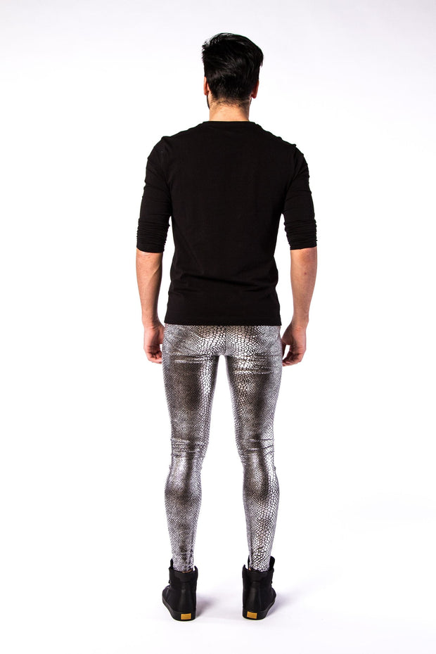 Man posing in Kapow Meggings metallic silver snakeskin men's leggings from behind