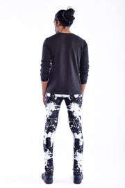 Man posing in Kapow Meggings black and white lightning print men's leggings from behind