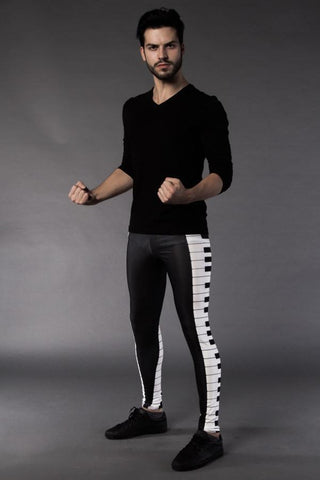 Man posing in Kapow Meggings Black and White piano key men's leggings