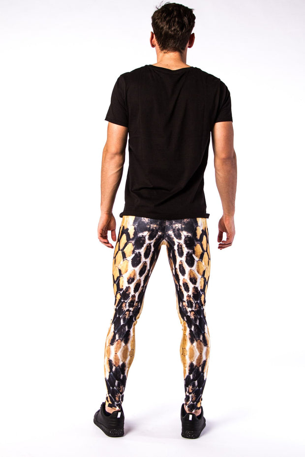Man posing in Kapow Meggings black, white and orange beehive themed men's leggings from behind