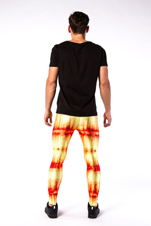 Man posing in Kapow Meggings red and yellow infra-red men's leggings from behind