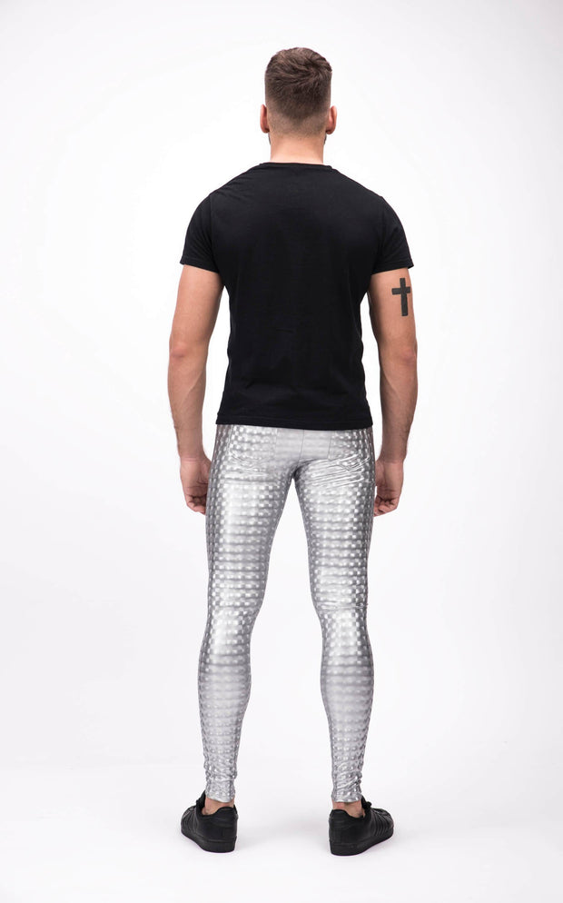 man wearing silver holographic leggings back