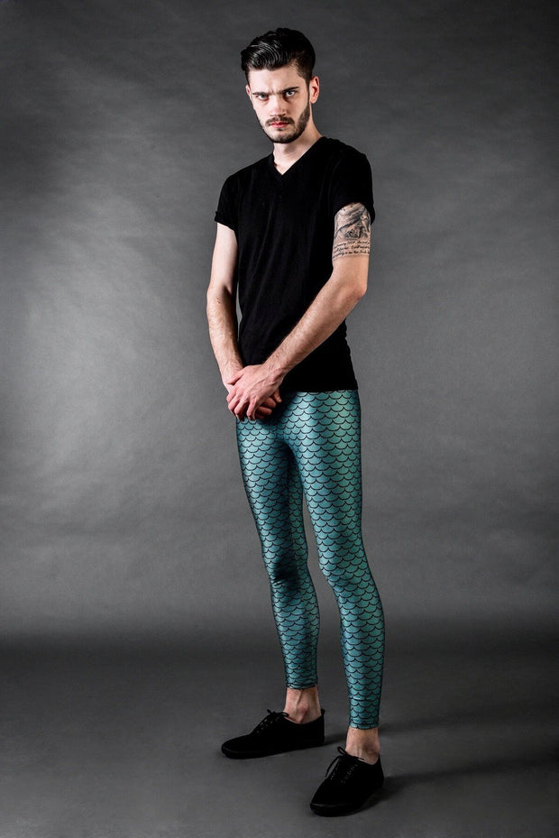 Man posing in Kapow Meggings metallic blue fish scales men's leggings