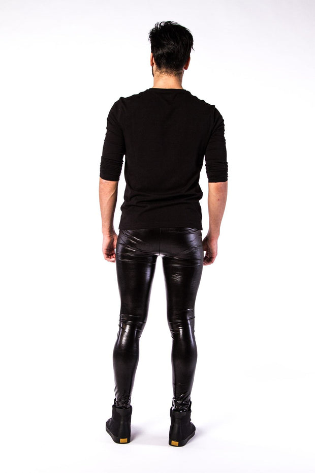 Man posing in Kapow Meggings black wet look men's leggings from behind