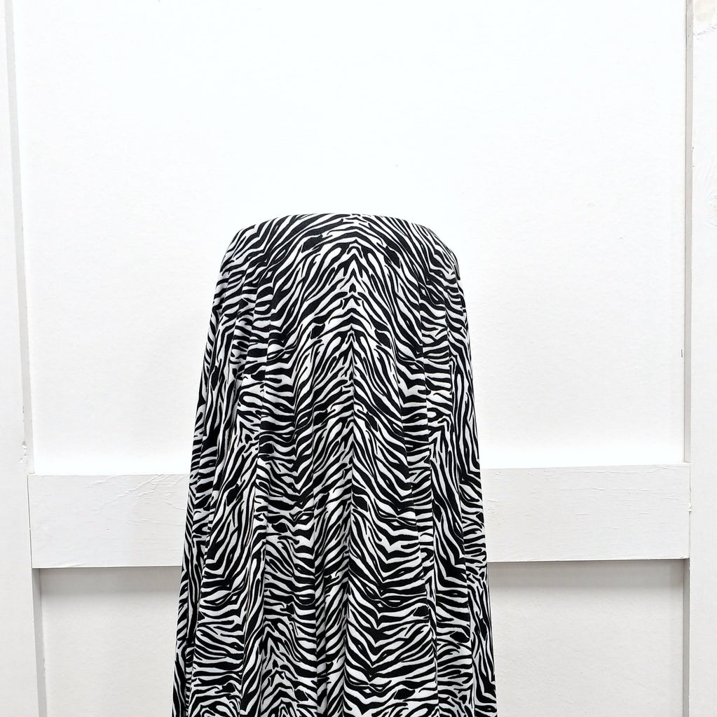 Black and White Zebra Print Double Brushed Poly Knit Fabric, By Elise Peterson for CLUB Fabrics - Raspberry Creek Fabrics