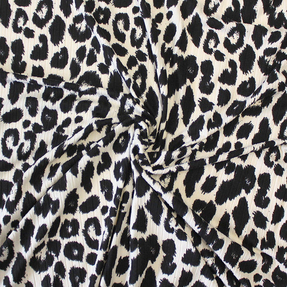Off White and Black Leopard Animal Print Poly Spandex 4 Way Stretch 8x3 Rib Knit - Raspberry Creek Fabrics