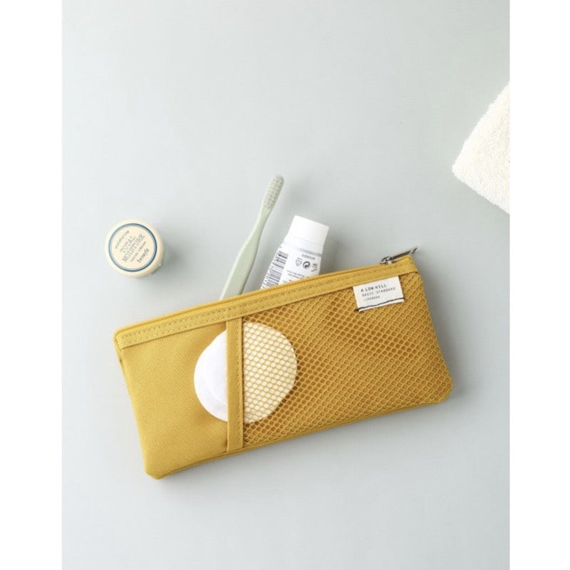 Mesh pocket pouch in mustard yellow