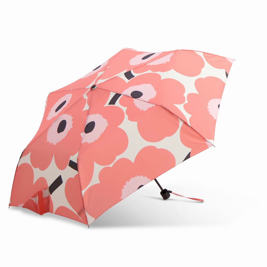 Marimekko umbrella in coral, beige and black Unikko pattern