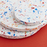 Round multi coloured Jesmonite Terrazzo placemats and coasters