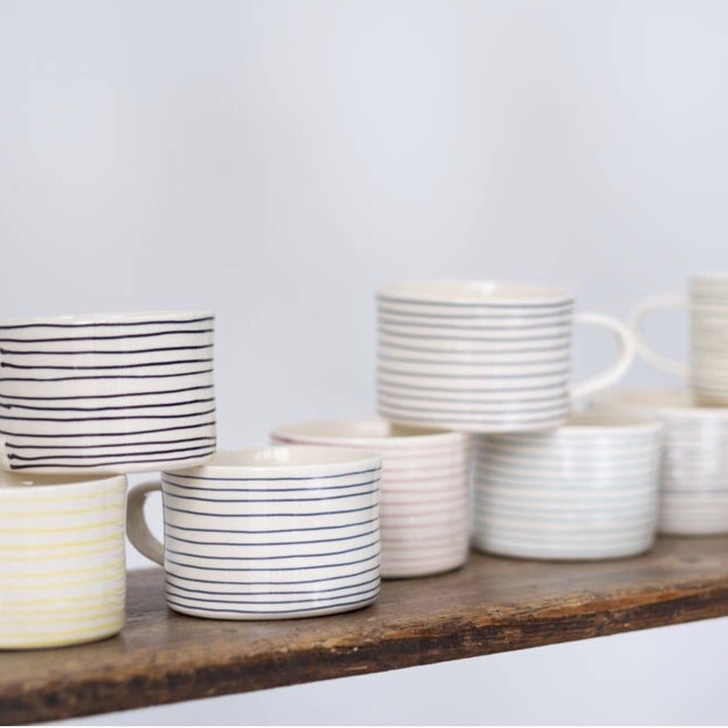 Ceramic thin striped mugs by Musango