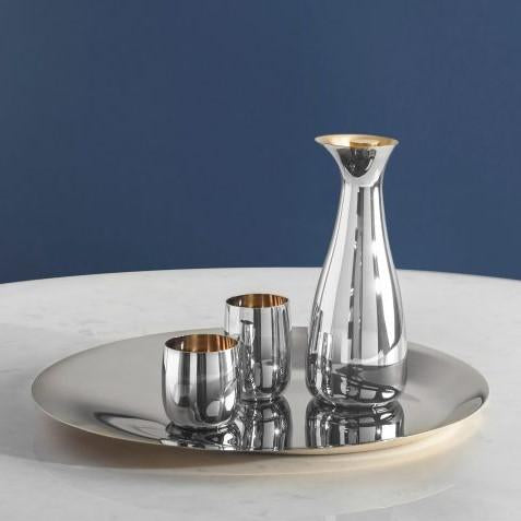 Polished steel  carafe with stopper designed by Sir Norman Foster