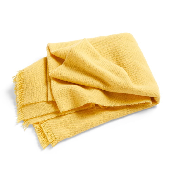 Soft wool blanket in lemon yellow by Hay