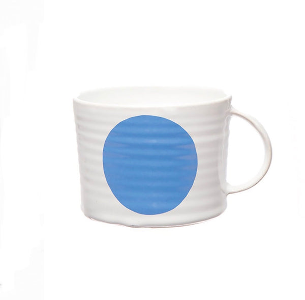 Camilla Engdahl's white stoneware cup with blue dot
