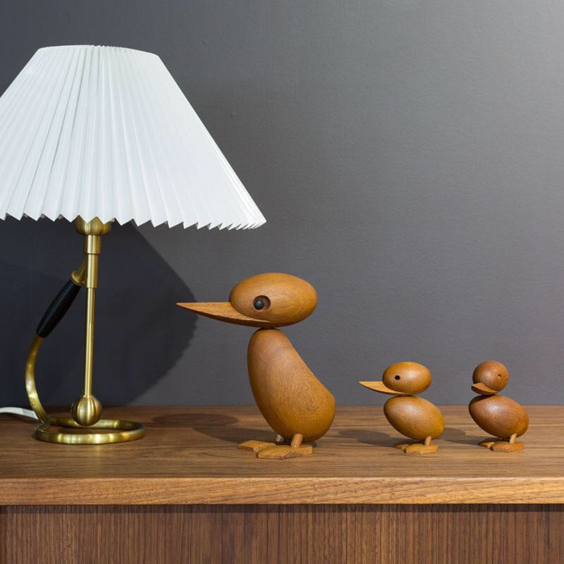 Architectmade teak wood duck and duckling ornaments designed by Hans Bølling