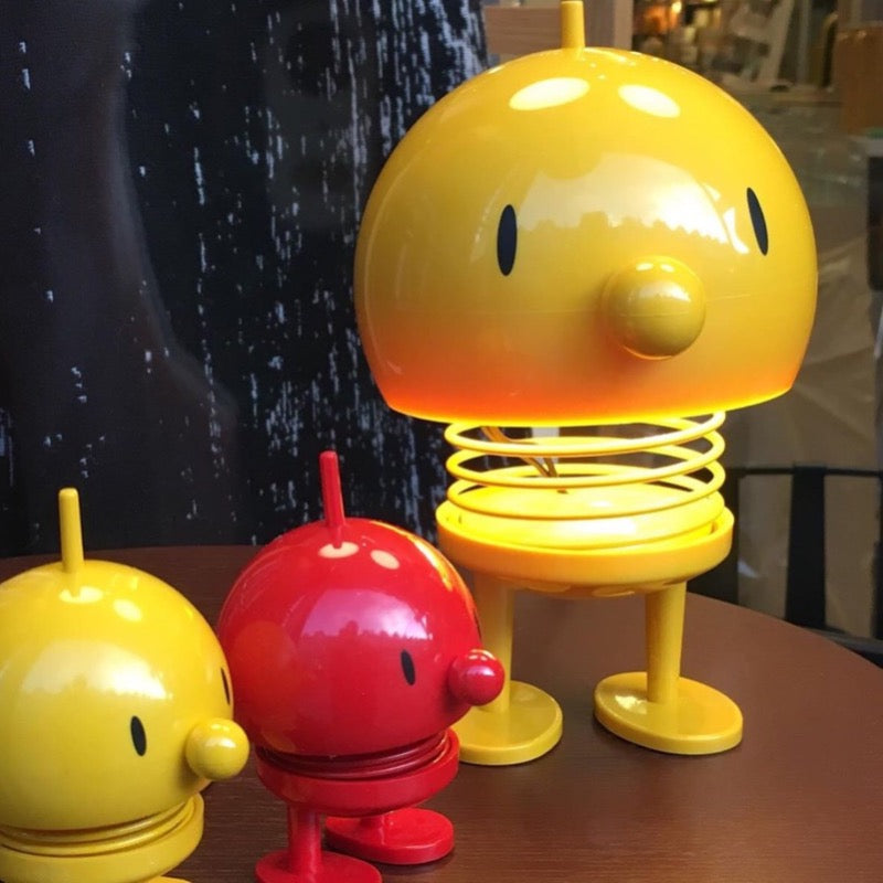 Yellow Bumble lamp and small red and yellow Bumbles at Indish Interiors