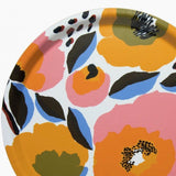 Round birch plywood tray in a white, red, yellow and blue Marimekko Rosarium pattern