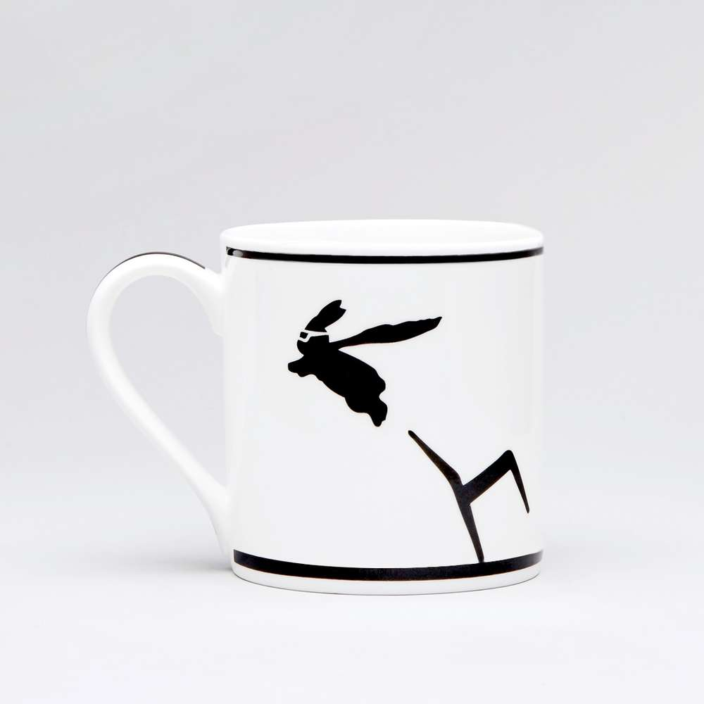 White ceramic mug decorated with a rabbit in black