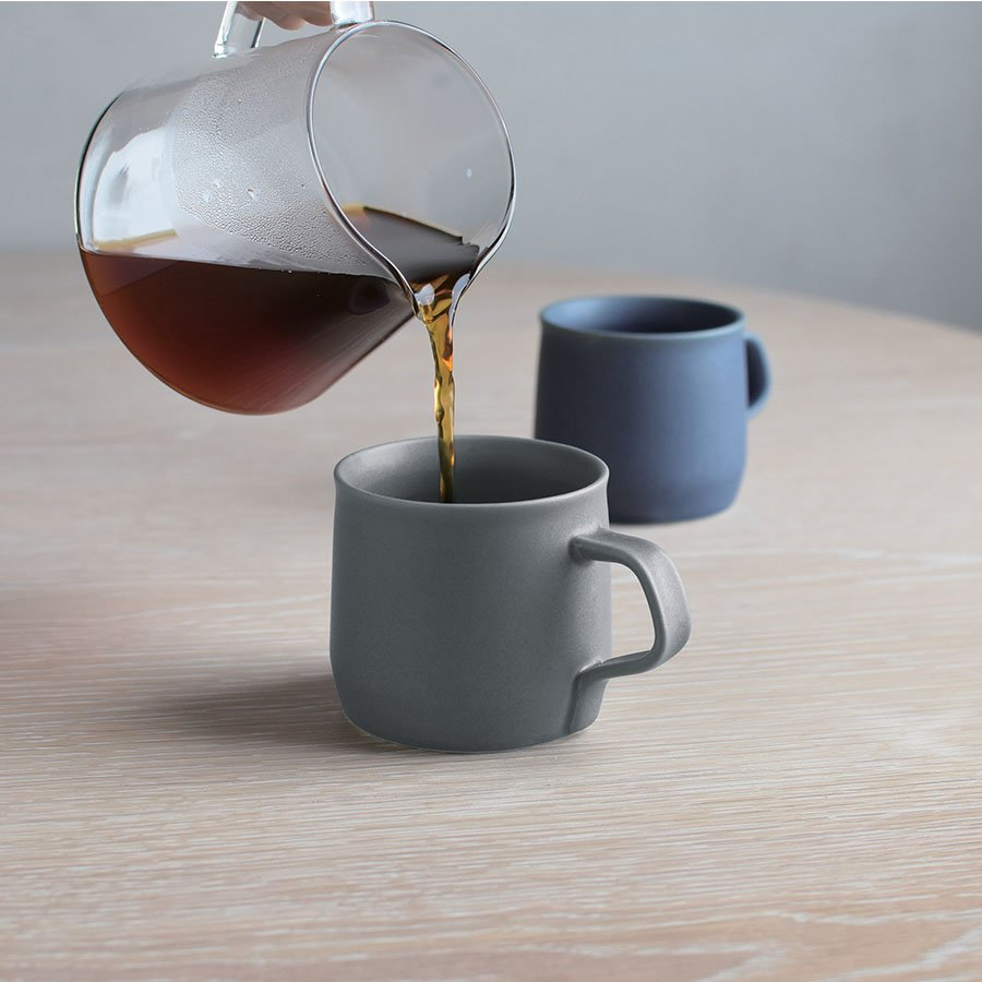 Dark grey and blue Fog porcelain mugs by Kinto