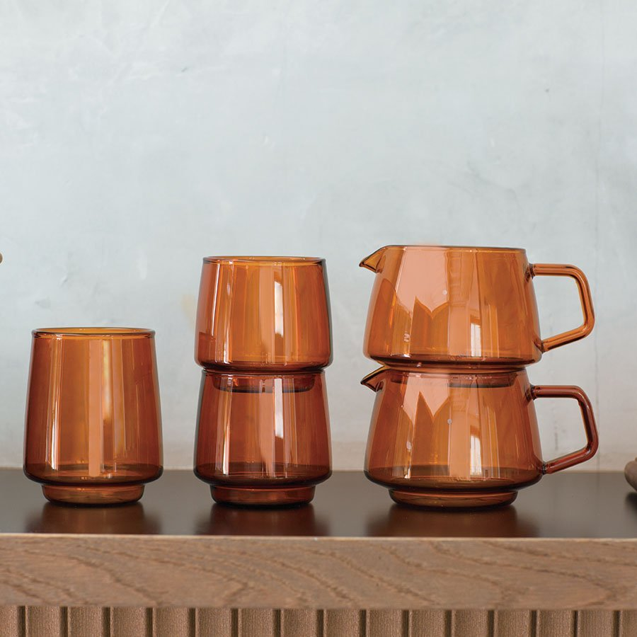 Amber glass tumblers and jugs