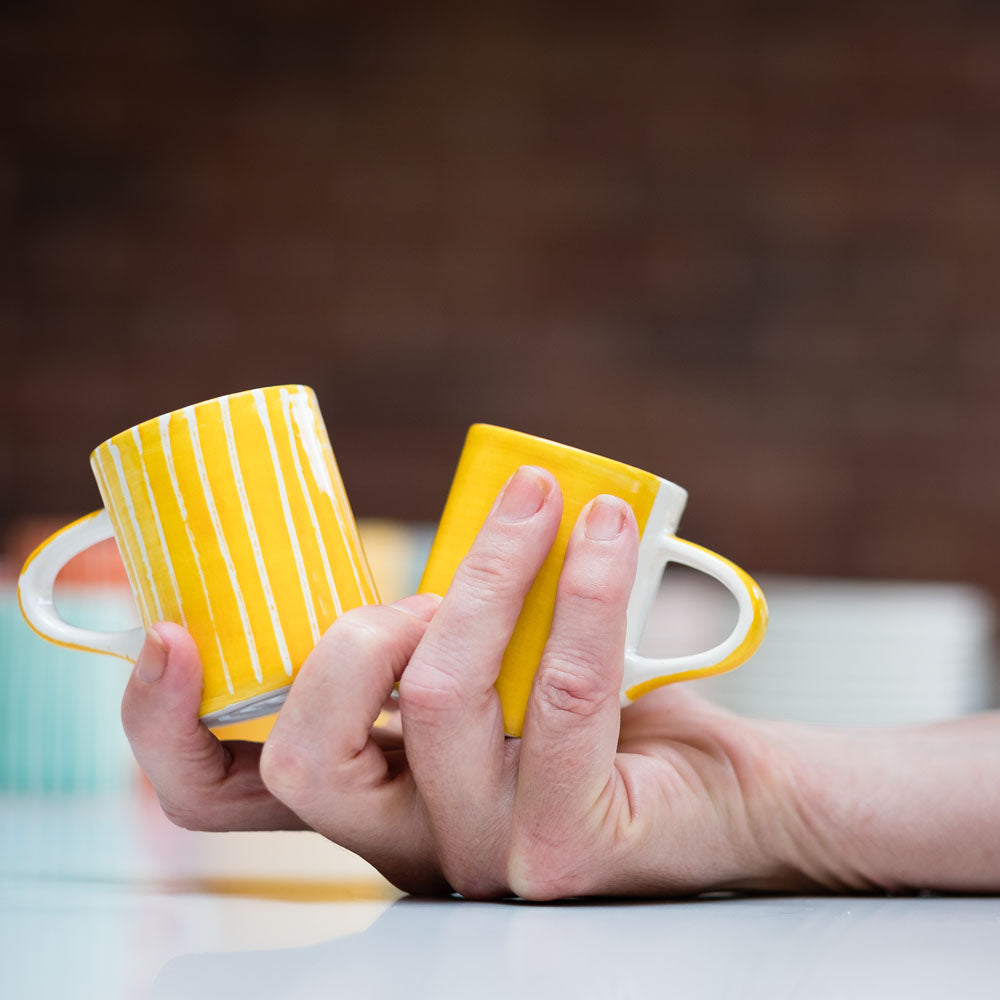 Ceramic espresso cups in turmeric stripes and wash