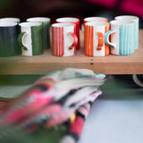 Ceramic espresso cups in light blue, red, green stripes and wash