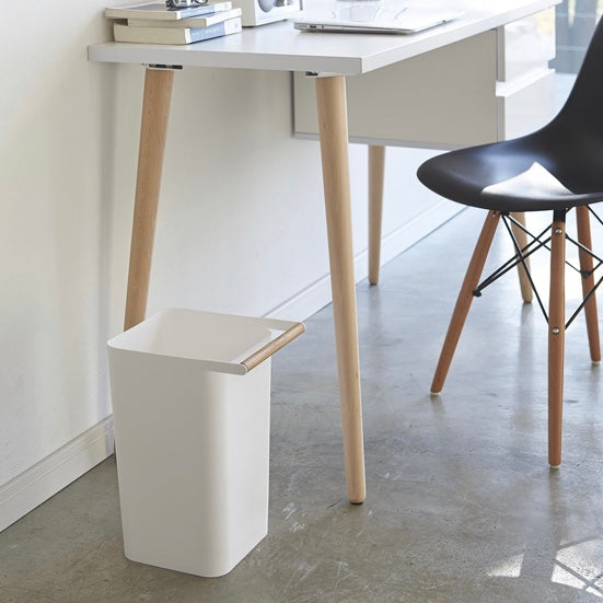 White plastic square bin with wooden handle