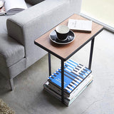 Dark wood and black metal small side table with magazine rack