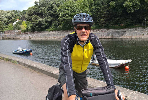cycling wearing clip on sunglasses