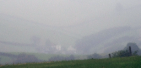 View across a valley in dull, misty conditions