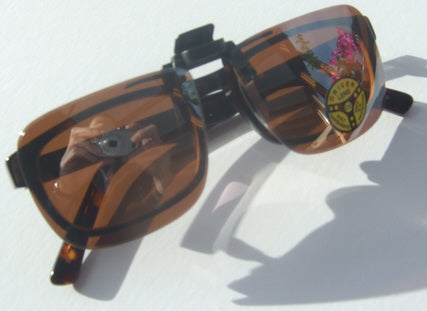 spring loaded clip on sunglasses over plastic frames