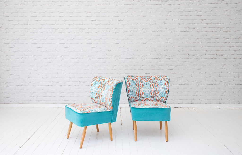 A pair of 1950s German fireside chairs in Egyptian hand printed cotton by Alef Gallery, Cairo