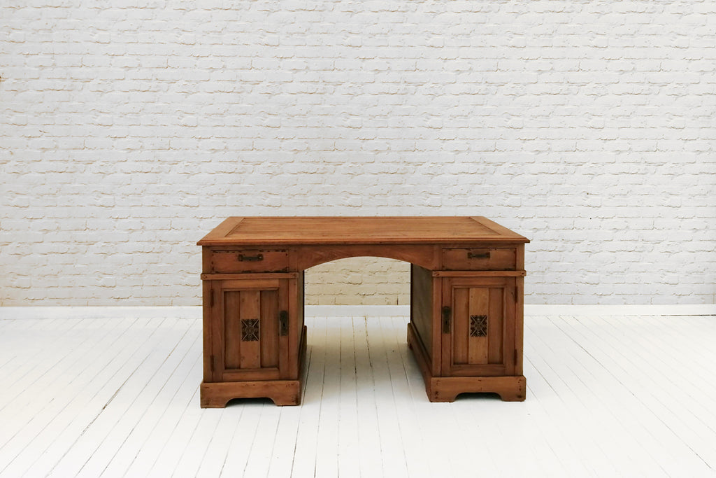 An antique Javanese partners desk with  carved door details
