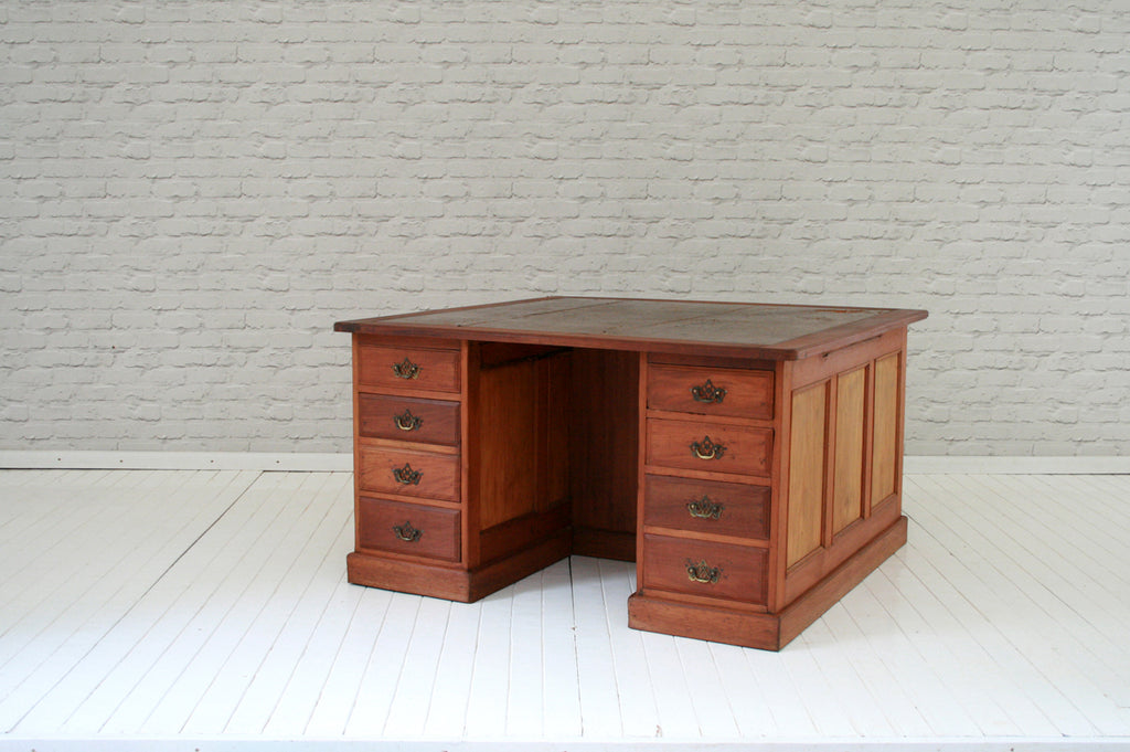 An Edwardian Mahogany  partner's desk with worn leather top