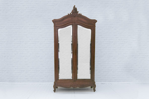An antique French oak armoire