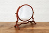 A Victorian oval shaped mahogany dressing table mirror