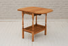 A 1930's oak two tier table with drop flaps / Side table