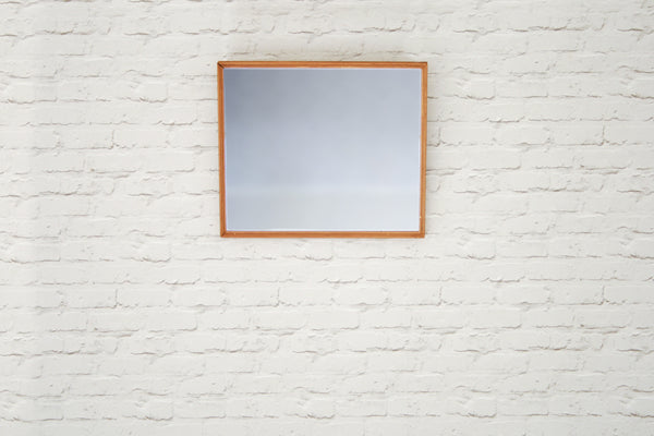 A vintage gold frame with newly fitted mirror