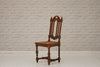 A carved oak dining chair