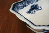 A large vintage blue patterned serving or salad bowl
