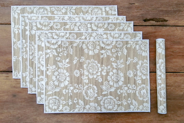 Woven grass placemats with screen printed patterns & fabric binding