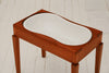 A 19th Century mahogany bidet with ceramic liner