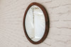 A vintage oak beveled edge mirror