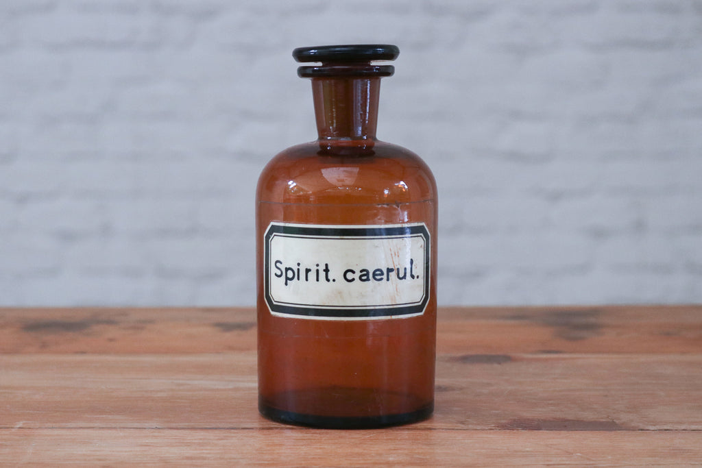 A vintage apothecary bottle