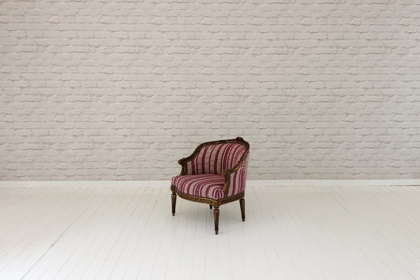 A 19th Century French boudoir chair upholstered in vintage West African pink Asoke