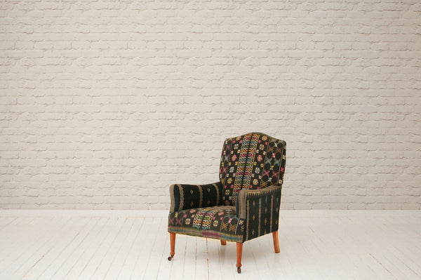 An Edwardian armchair upholstered in vintage ceremonial hand-embroidered sarong