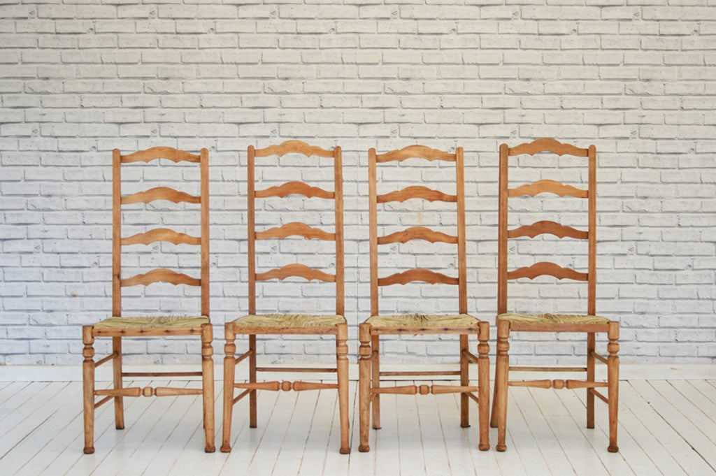 A set of four ladderback dining chairs