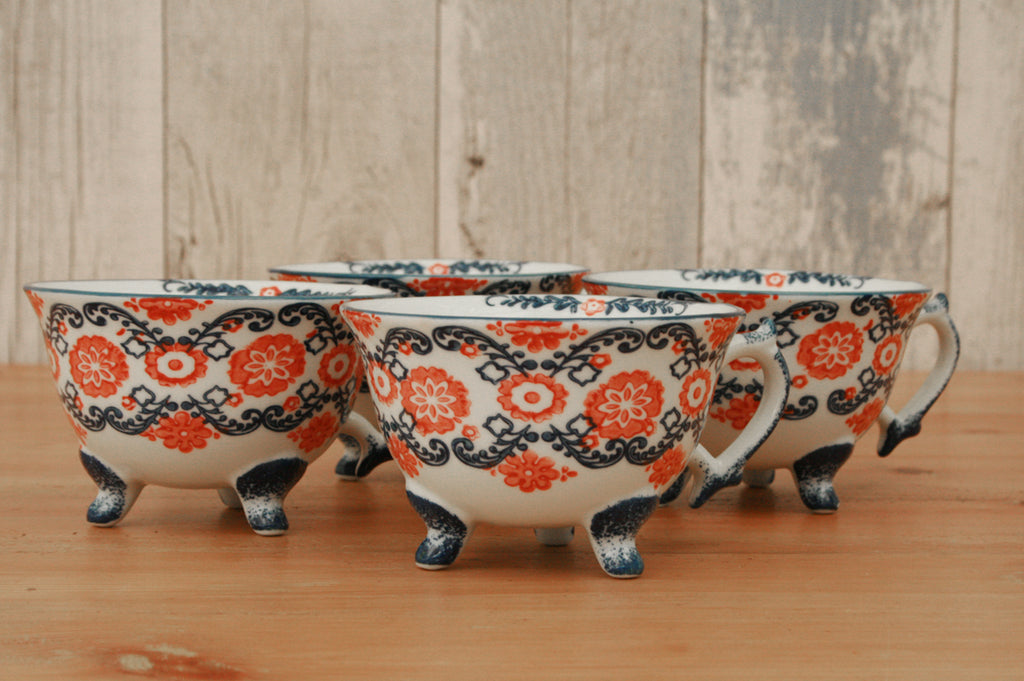 A pair of Blue and Red Patterned Teacups