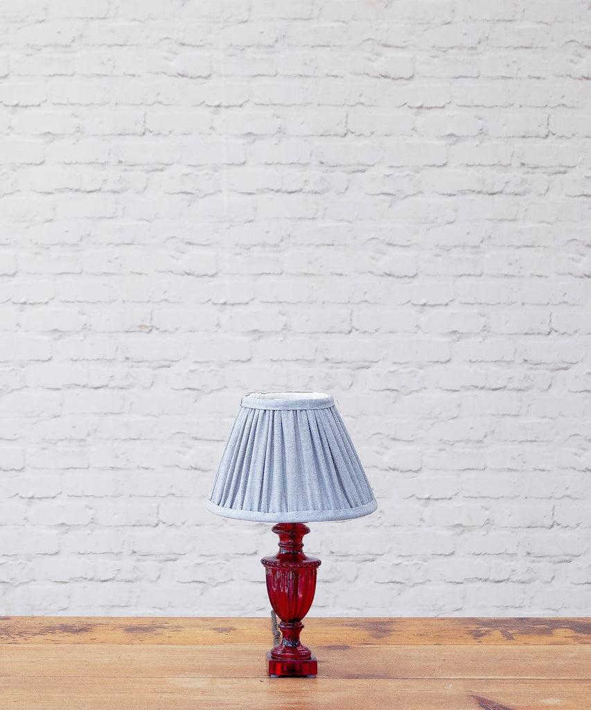 Urnie resin table lamp with a gathered stonewash shade